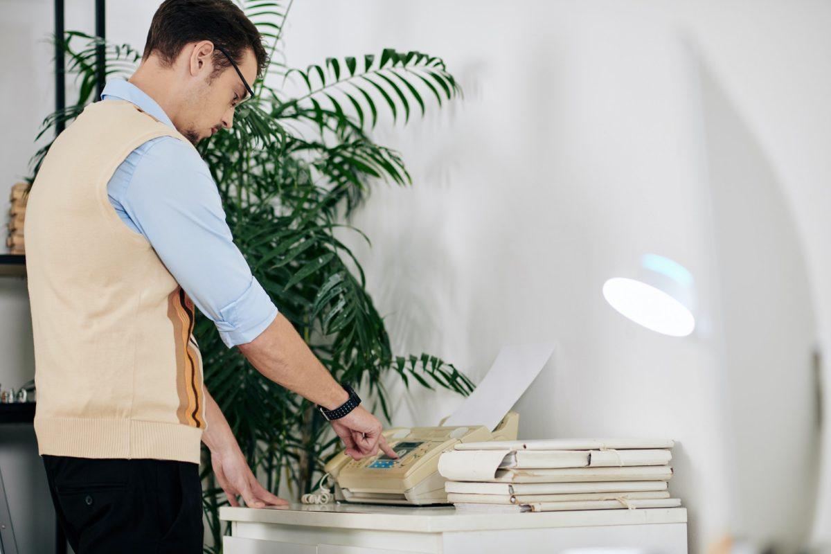 Businessman receiving fax